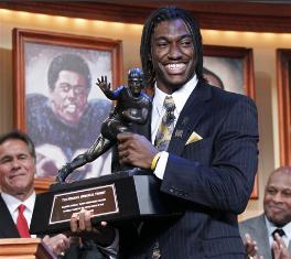 QB Robert Griffin III is all smiles while showing off the 2011 Heisman Trophy at the awards ceremony on December 10, 2011 Griffin III was the top rated QB in the nation and led the Bears to a 9-3 regular season record.
