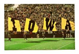 I-O-W-A This tradition takes place when the team is led onto the field by four giant black and gold flags, spelling I-O-W-A. Each flag then moves to the touchdown, fans in the four corners of the field, initially aided by the flags, spell out I-O-W-A