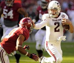 "Striking a Heisman Pose? Instead of having a ""Heisman moment"" against top-ranked Alabama, Manziel had a ""Heisman game"" by stunning the Tide. The Aggies QB dissected the Alabama defense with three quick 1Q TDs as the Aggies held on to a sweet victory."