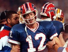 """Four """"Bad Bills"""" Despite dominating the AFC in the early 1990s, Jim Kelly's Buffalo Bills anguished through four consecutive Super Bowl losses."""