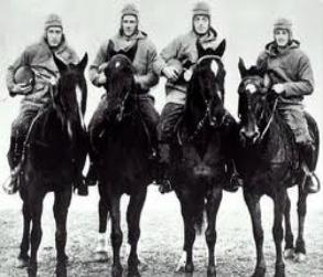 Quarterback Harry Stuhldreher, left halfback Jim Crowley, right halfback Don Miller and fullback Layden. They are the Notre Dame backfield more commonly known as the Four Horsemen.