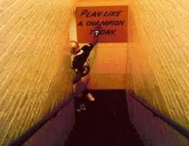 "One of Notre Dame's great gameday traditions is the hitting of the ""Play Like Champions Today"" sign as they exit the locker room."
