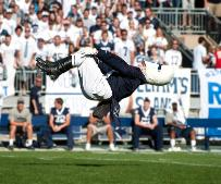 Penn State's Pregame Flip A fan favorite gameday tradition is delivered by the marching band's drum major. Twice during the Blue Band pregame drill, the drum major performs a forward flip. The first flip is executed on the 50-yard line and the second one is completed on the South goal line.