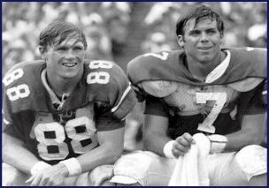 Sullivan (R) is shown sitting with his favorite receiving target, WR Terry Beasley on the Auburn sidelines
