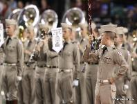 The Fightin' Texas Aggie Band Known as the largest military marching band in the nation, the 300+ member group is nationally known for its precision military marching formations while performing at Kyle Field.